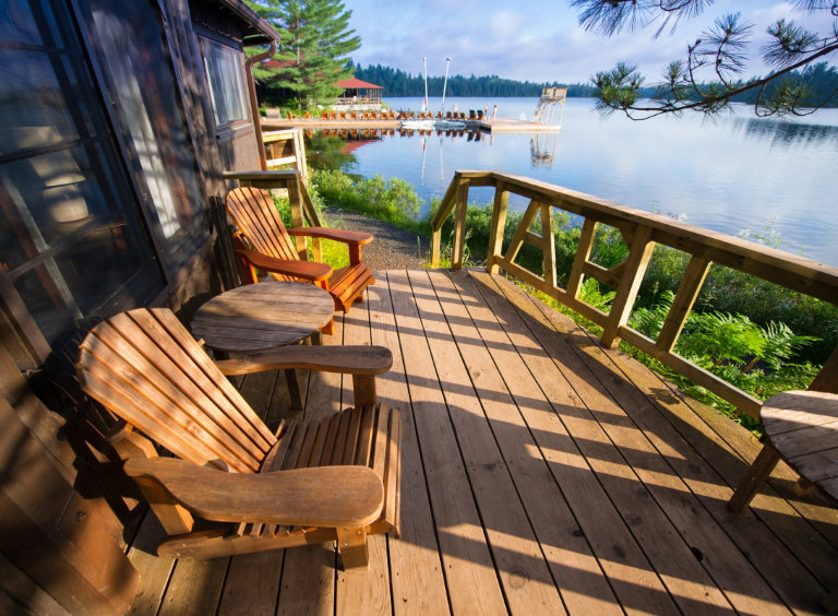 cottage chairs overlooking lake